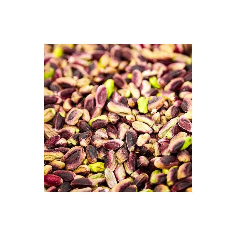 Traditional and delicious cake with Sicilian Pistachios in a red tin By D&G.